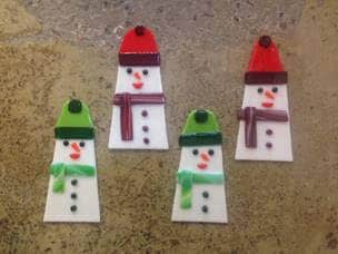 4 snow men fused glass Christmas ornaments made in a team building activity